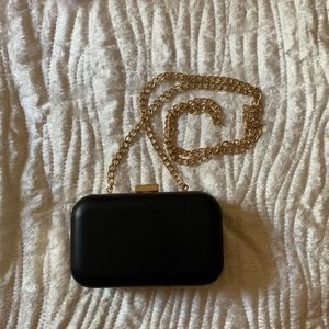 Black clutch with gold detailing